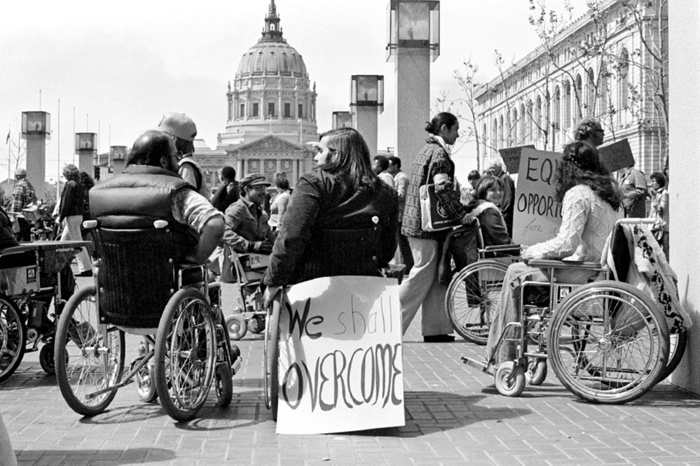 Protesters in wheelchairs outside a federal building in San Francisco. Photo credit: Anthony Tusler